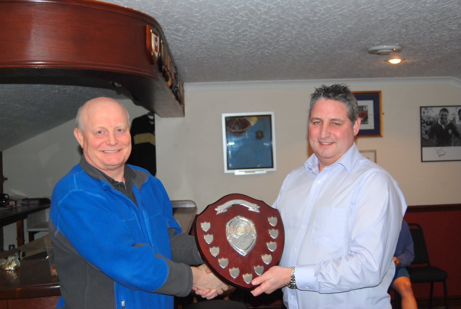 Newton Abbot's Phil Whiting receives the BWWPL Shield for the Women's Division 2011.