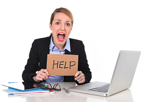 young stressed businesswoman holding help sign overworked at office computer